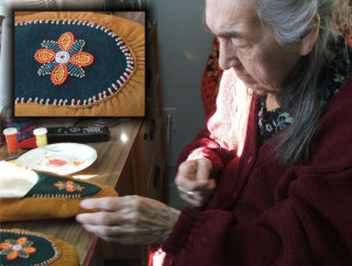 Mary Voisey showing how beading should be done. Photo: Eva Luther