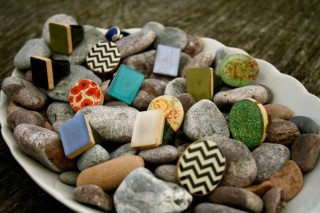 A bowl of small beach stones used to display contemporary rings. Photo: Lighthouse Gifts